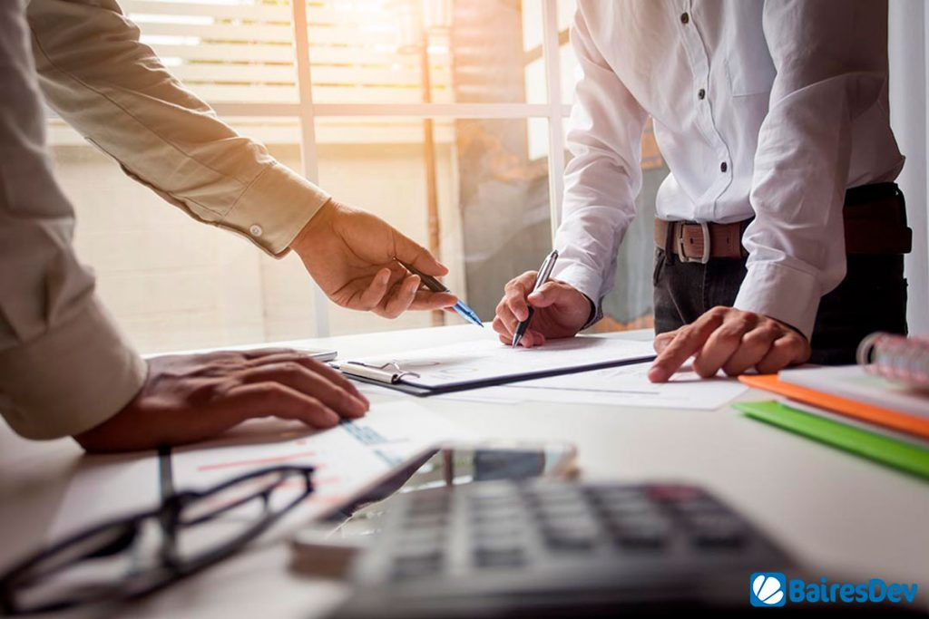 Business man creating a Service Level Agreement SLA With an Outsourcing Company
